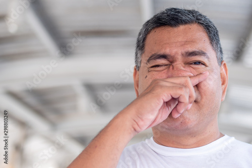 allergic sick old man having cold, flu, allergy with runny nose Fototapet