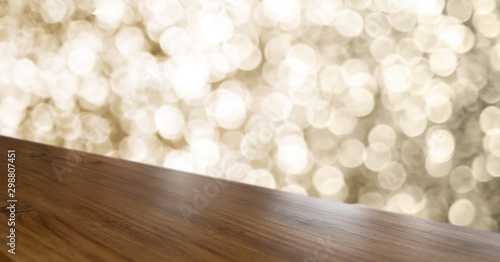 Fotografie, Obraz  Empty old rustic angle wood table top with blur sparkling gold bokeh abstract background,panoramic banner for display or montage of product,Holiday seasonal concept backdrop