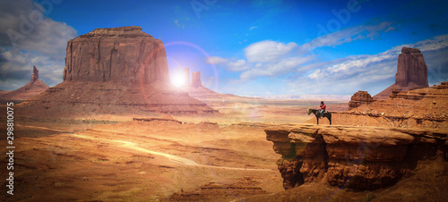 Leinwand Poster Legendary scene of a cowboy in Monument Valley (USA)