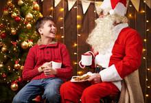 Santa Claus And Child Boy Drin...