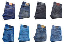 Collection Of Folded Jeans Trousers Isolated On White Background.
