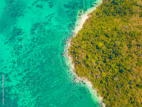 Poster Vert corail Aerial view of Phi Phi, Maya beach with blue turquoise seawater, mountain hills, and tropical green forest trees at sunset with Andaman sea in Phuket island in summer, Thailand in travel trip. Nature.