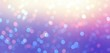 Iridescent bokeh luxury banner. New Year night empty background. Glitter on yellow pink violet magic backdrop. Gleam texture.