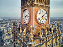 Beautiful Panoramic Aerial Close-up Drone View To The Millennium Clock (clock Face Diameter = 6.5 M) On The Tower Of PKiN And Cityscape Of Warsaw Modern City, Poland