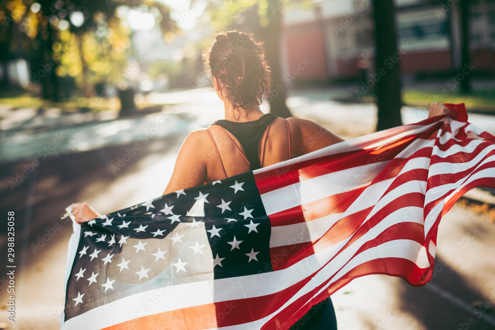 Fototapety, obrazy: Athletic young woman running with american flag.
