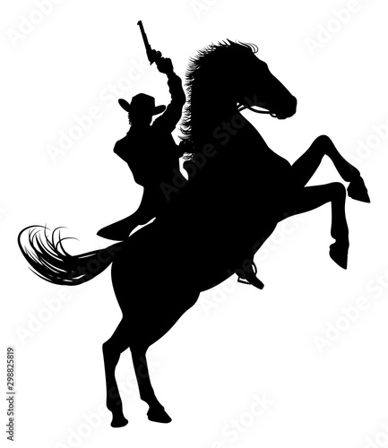 Photo A cowboy riding a horse in silhouette waving pistol in the air