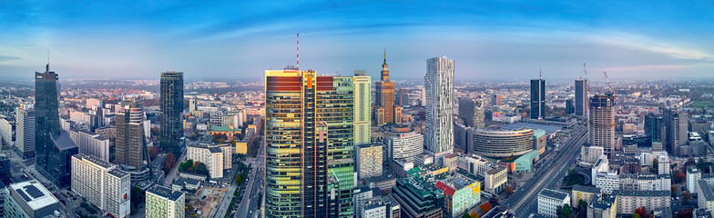 FototapetaBeautiful panoramic aerial drone view to panorama cityscape of Warsaw modern City, PKiN and