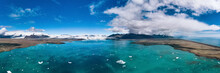 Iceland, Panorama Of Jokulsarlon Lagoon. Picturesque Blue Landscape Of Icelandic Glacier Lagoon. Icelandic Famous Landmark During Summer Season.