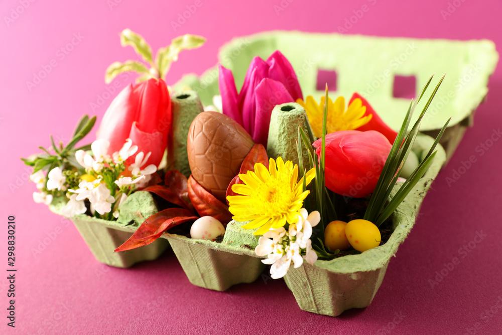 Fototapeta egg box with flower, tulip, chocolate egg- easter day festive