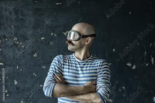 Photo portrait of a steam punk hipster, mustachioed man posing, face, mustache