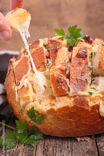 Tuinposter Brood baked bread with ham, bacon and cheese