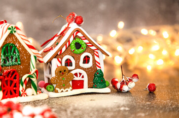 gingerbread, Christmas gingerbread house on the background of a New Year's garland