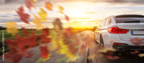 Foto op Canvas Wild West Fast Car on autumn landscape road at sunset