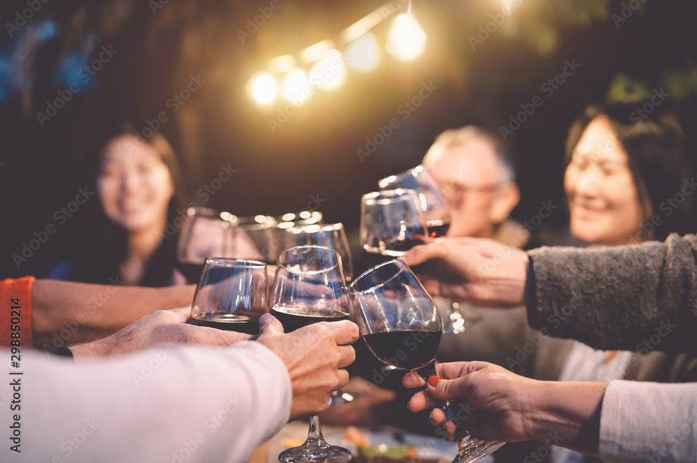 Fototapety, obrazy: Happy family cheering with red wine at reunion dinner in garden - Senior having fun toasting wineglasses and dining together outdoor - People and food lifestyle concept
