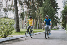 Beautiful Sporty Couple Riding Bikes And Smiling