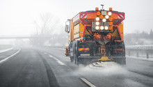 Snow Plow Salting Street In Wi...