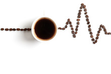 Cardiogram Painted With Coffee Beans And Cup Of Coffee On White Background. The Concept Of The Effect Of Caffeine On The Heart.