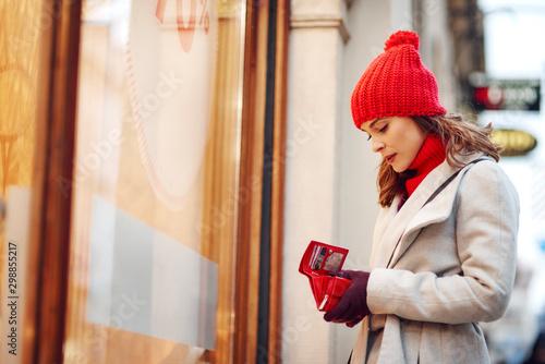 Obraz na plátně  Woman spent all her money during Christmas shopping