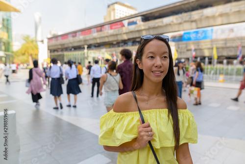 Young beautiful tourist woman exploring the city of Bangkok Wallpaper Mural