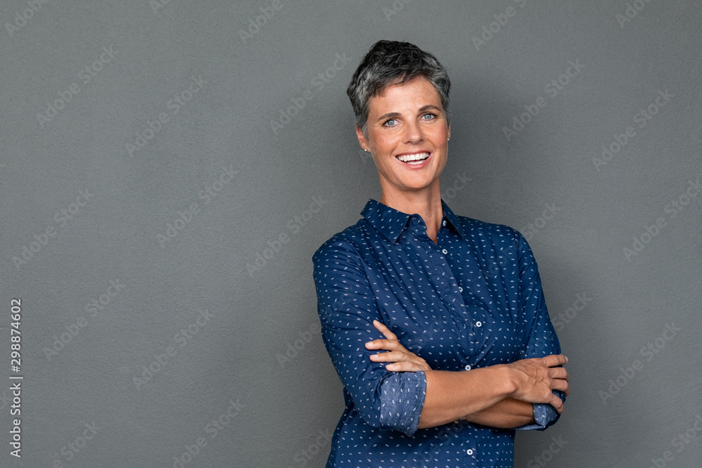 Fototapety, obrazy: Happy mature woman laughing on grey wall