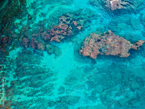 Aerial view of rocks in the sea. Overview of the seabed seen from above, transparent water. Seabed. Pizzo Calabro, Calabria, Italy
