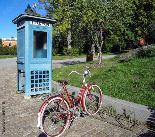 Fotografie, Obraz Retro telephone booth and bike
