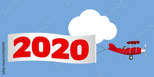 Photo Carte de vœux pour la nouvelle année, montrant un avion rouge à hélice tirant une banderole blanche annonçant l'année 2020