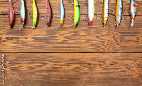 Fotomural Lures in the form of wobblers and spinners on a wooden background