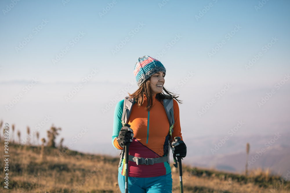Fototapety, obrazy: Young woman hiker standing at the mountaintop