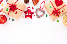 Christmas Composition. Beautiful Toys, Gifts And Candy On The White Background. New Year Background. Top View. Close Up. Space For A Text.