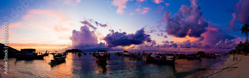 Foto  Panorama view of sunrise morning beach with boat sky cloud