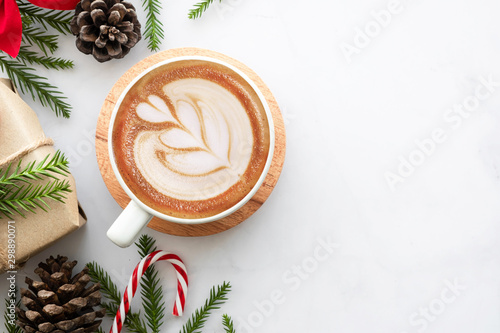 White marble table with cup of latte coffee and Christmas decoration with gift box Poster Mural XXL