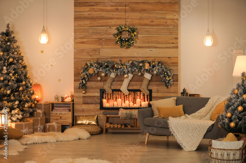 Valokuva  Stylish room interior with beautiful Christmas tree and decorative fireplace