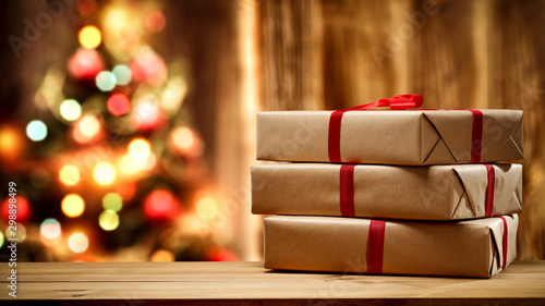 Fototapeta Christmas gift and wooden wall background.  obraz