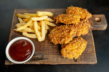 Fried Chicken With French Fries And Food Nuggets - On Stone Background