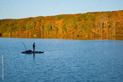 Valokuvatapetti Fishrman in Risley Park Vernon Connecticut during autumn fall with beautfull fol