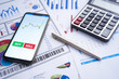 Business and finance with analytical study on market trend or demand with document on paper, calculator, smartphone, laptop and a pen