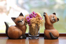 Ceramic Cats With Flower Pot On Wooden Table.
