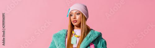 panoramic shot of thoughtful, stylish african american woman with tags on clothing isolated on pink, fashion doll concept - 298906095
