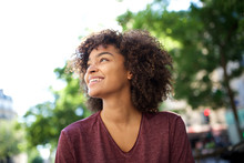 Close Up Smiling African American Girl With Curly Hair Looking Away