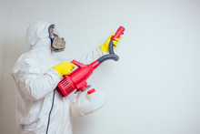 Pest Control Worker Spraying Pesticides With Sprayer In Apartment Copy Spase White Walls Background