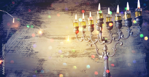 Fotomural  Religion image of jewish holiday Hanukkah background with menorah (traditional c