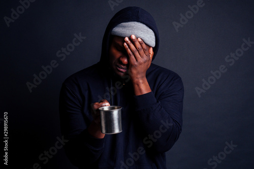 sad look african american man holding metal tourist thermos cup bad feeling Canvas Print