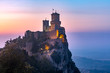 canvas print picture - Guaita fortress or Prima Torre on the ridge of Mount Titano, in the city of San Marino of the Republic of San Marino at sunset