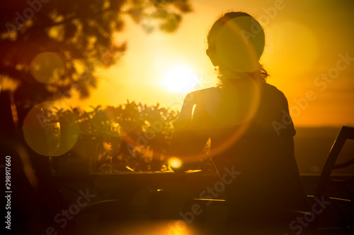 Sunset with the sun against leaving a beautiful silhouette. Wallpaper Mural