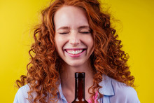 Redhaired Ginger Woman Holding...