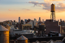 Summer Sunset Light On Chelsea Rooftops With Water Towers, Manhattan, New York City, NY, USA