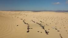 Aerial Of 4x4 Trucks, UTVs, ATV's And Buggies Recreating At Glamis Sand Dunes, California