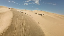 ATVs, Dune Buggies And Off Road Vehicles Riding Down Oldsmobile Hill At  Glamis Sand Dunes, Aerial Push In.