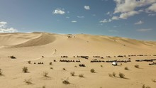 Aerial Lateral Shot Of OHV Vehicles Race In Glamis Sand Dunes, California